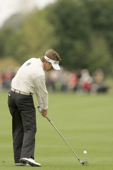 Scott Drummond watches his approach shot during the rain delayed first round of the 2005 Deutsche Bank Players' Championship at Gut Kaden Golf Club on July 22, 2005.Photo by Pete Fontaine/WireImage.com