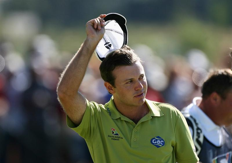 PAARL, SOUTH AFRICA - DECEMBER 21:  Richard Sterne of South Africa celebrates winning the South African Open Championship on the first play-off hole against Gareth Maybin of Northern Ireland at Pearl Valley Golf & Country Club on December 21, 2008 in Paarl, South Africa.  (Photo by Warren Little/Getty Images)