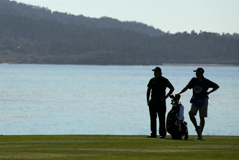 PEBBLE BEACH, CA - FEBRUARY 12:  Phil Mickelson waits to hit his second shot on the 8th hole during the third round of the AT&T Pebble Beach National Pro-Am at the Pebble Beach Golf Links on February 12, 2011 in Pebble Beach, California.  (Photo by Ezra Shaw/Getty Images)