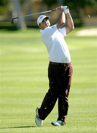 BERMUDA DUNES, CA - JANUARY 24:  Pat Perez hits his second shot on the seventh hole at the Bermuda Dunes Country Club during the fourth round of the Bob Hope Chrysler Classic on January 23, 2009 in Bermuda Dunes, California.  (Photo by Stephen Dunn/Getty Images)