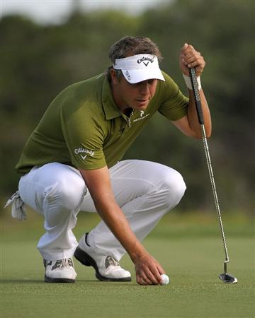SAN ANTONIO, TX - MAY 15:  Fredrik Jacobson lines up a birdie putt on the 5th hole during the second round of the Valero Texas Open at the TPC San Antonio on May 15, 2010 in San Antonio, Texas. (Photo by Marc Feldman/Getty Images)