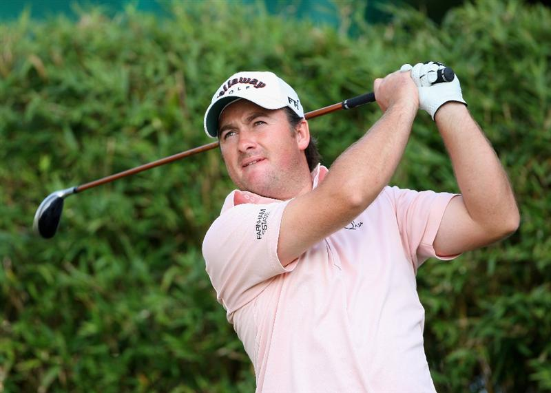 HONG KONG, CHINA - NOVEMBER 20:  Graeme McDowell of Northern Ireland plays his tee shot on the 17th hole during the first round of the UBS Hong Kong Open at the Hong Kong Golf Club on November 20, 2008 in Fanling, Hong Kong.  (Photo by Stuart Franklin/Getty Images)
