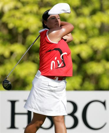 SINGAPORE - FEBRUARY 27: Christina Kim of the USA hits her tee shot on the sixth tee during the final round of the HSBC Women's Champions at Tanah Merah Country Club  on February 27, 2011 in Singapore, Singapore.  (Photo by Ross Kinnaird/Getty Images)