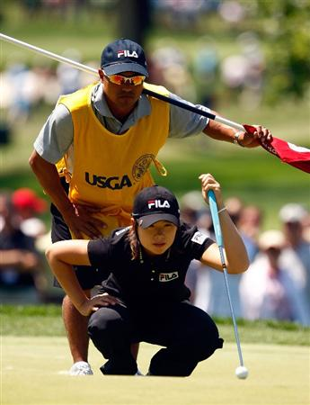 BETHLEHEM, PA - JULY 12:  Eun Hee Ji of South Korea lines up a putt with her caddie Zac Austin on the second green during the final round of the 2009 U.S. Women's Open at the Saucon Valley Country Club on July 12, 2009 in Bethlehem, Pennsylvania.  (Photo by Scott Halleran/Getty Images)