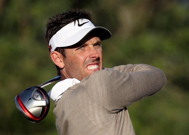 DOHA, QATAR - JANUARY 28:  Charl Schwartzel of South Africa on the 18th tee during the first round of The Commercialbank Qatar Masters at The Doha Golf Club on January 28, 2010 in Doha, Qatar.  (Photo by Ross Kinnaird/Getty Images)