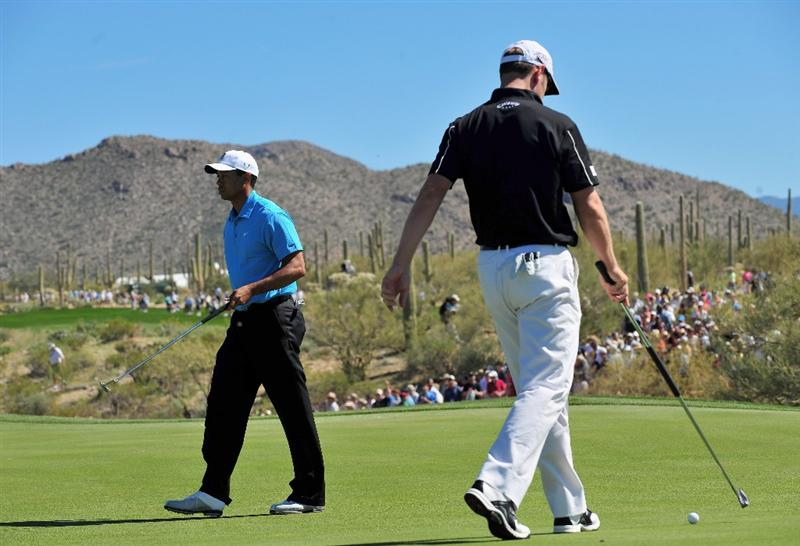 MARANA, AZ - FEBRUARY 25:  Tiger Woods of the USA and Brendan Jones of Australia walk on the first green during the first round of Accenture Match Play Championships at Ritz - Carlton Golf Club at Dove Mountain on February 25, 2009 in Marana, Arizona.  (Photo by Stuart Franklin/Getty Images)