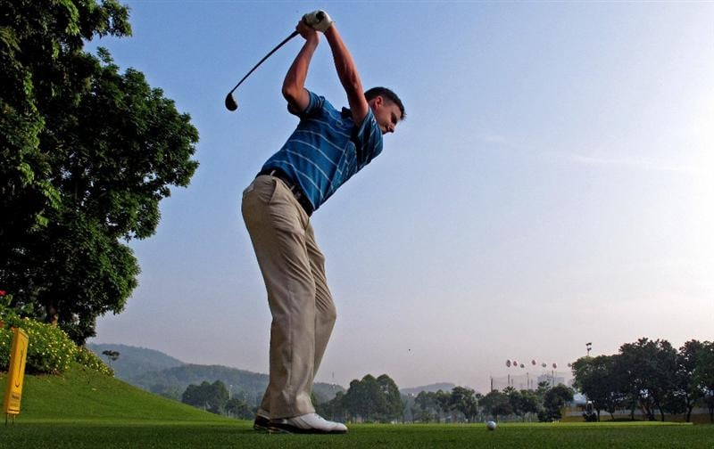 KUALA LUMPUR, MALAYSIA - MARCH 03:  Peter Lawrie of Ireland hits his tee-shot on the 16th hole during practice prior to the start of the Maybank Malaysian Open at the Kuala Lumpur Golf and Country Club on March 3, 2010 in Kuala Lumpur, Malaysia.  (Photo by Andrew Redington/Getty Images)