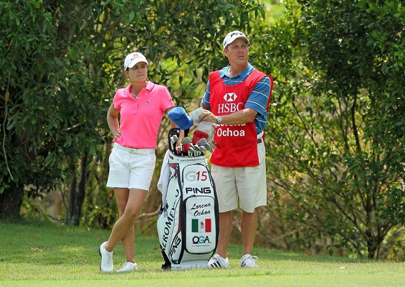 SINGAPORE - FEBRUARY 25:  Lorena Ochoa of Mexico and her caddie are pictured on the 17th hole during the first round of the HSBC Women's Champions at Tanah Merah Country Club on February 25, 2010 in Singapore, Singapore.  (Photo by Andy Lyons/Getty Images)