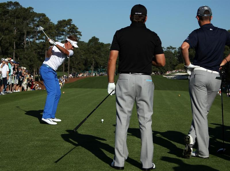 AUGUSTA, GA - APRIL 04:  Ian Poulter (L) of England hits a shot as Graeme McDowell (C) of Northern Ireland and Justin Rose (R) look on during a practice round prior to the 2011 Masters Tournament at Augusta National Golf Club on April 4, 2011 in Augusta, Georgia.  (Photo by Andrew Redington/Getty Images)