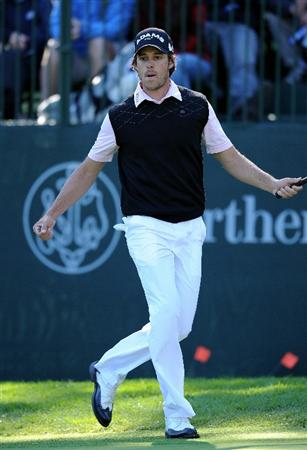 PACIFIC PALISADES, CA - FEBRUARY 20:  Aaron Baddeley of Australia jumps in the air as he celebrates holing his birdie putt on the 13th hole during the final round of the Northern Trust Open at Riviera Country Club on February 20, 2011 in Pacific Palisades, California.  (Photo by Stuart Franklin/Getty Images)