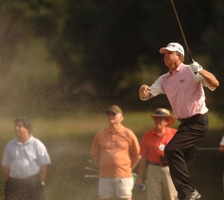 Dana Quigley reacts to a blast of sand on his approach shot on the 15th fairway during the final round of the Champion's TOUR 2005 SBC Championship at Oak Hill Country Club in San Antonio, Texas October 23, 2005.Photo by Steve Grayson/WireImage.com