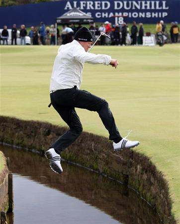 ST. ANDREWS, UNITED KINGDOM - OCTOBER 1:  Peter Hedblom of Sweden jumps over the brook on the first hole during the final practice round of The Alfred Dunhill Links Championship at The Old Course on October 1, 2008 in St.Andrews, Scotland. (Photo by Warren Little/Getty Images)