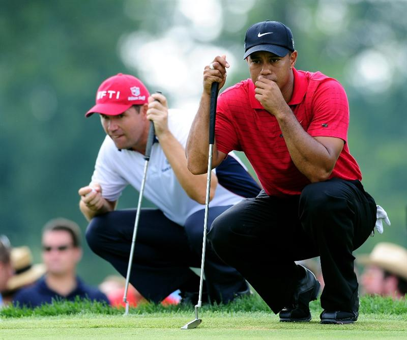 AKRON, OH - AUGUST 09:  Tiger Woods of USA and Padraig Harrington (L) of Ireland line up their putts on the 12th hole during the final round of the World Golf Championship Bridgestone Invitational on August 9, 2009 at Firestone Country Club in Akron, Ohio.  (Photo by Stuart Franklin/Getty Images)