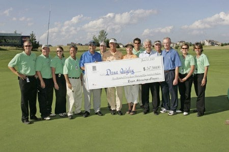 Dana Quigley holds the check after winning the playoff round of the Bayer Advantage Classic held at LionsGate Golf Course in Overland Park, KS. on June 13, 2005.Photo by G. Newman Lowrance/WireImage.com