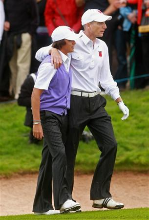 NEWPORT, WALES - OCTOBER 02:  Jim Furyk (R) consoles his playing partner Rickie Fowler after Fowler dropped the wrong type of golf ball on the fourth hole and cost them the hole during the rescheduled Afternoon Foursome Matches during the 2010 Ryder Cup at the Celtic Manor Resort on October 2, 2010 in Newport, Wales.  (Photo by Andrew Redington/Getty Images)