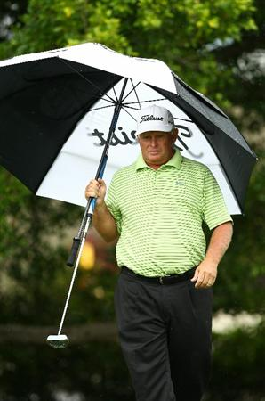 PERTH, AUSTRALIA - NOVEMBER 21:  Peter Senior of Australia walks up to the 4th green during day three of the 2010 Australian Senior Open at Royal Perth Golf Club on November 21, 2010 in Perth, Australia.  (Photo by Paul Kane/Getty Images)