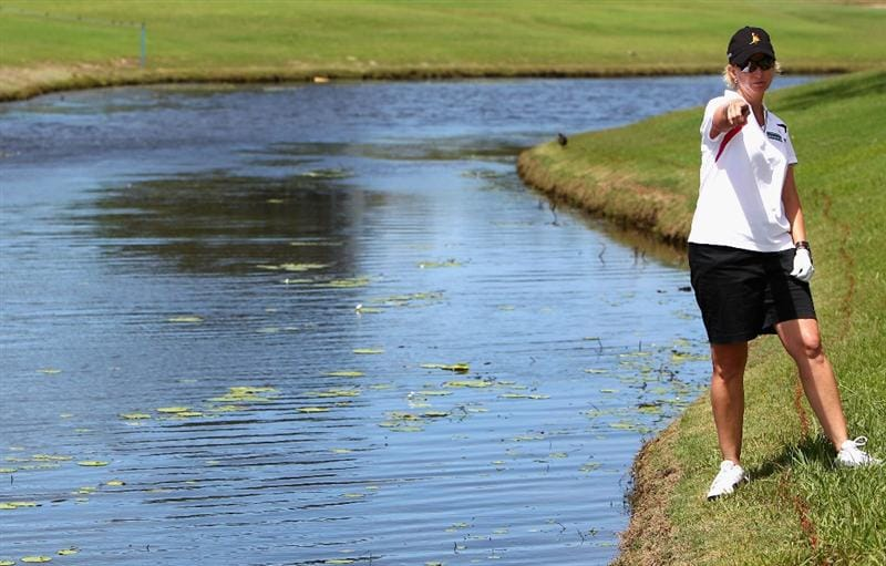 GOLD COAST, AUSTRALIA - MARCH 04:  Karrie Webb of Australia looks for her ball after hitting in into the water on the 8th hole during round one of the 2010 ANZ Ladies Masters at Royal Pines Resort on March 4, 2010 in Gold Coast, Australia.  (Photo by Ryan Pierse/Getty Images)
