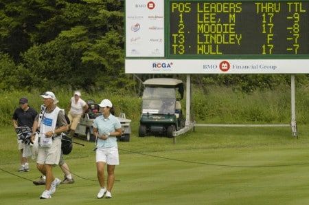 Meena Lee, of South Korea, walks to the eighteenth green with her caddie Mike McGuire with a one shot lead over Janice Moodie, of Scotland, during final round of the BMO Financial Group Canadian Women's Open in Halifax, NS, Sunday, July 17, 2005. Lee won the tournament with a 9-under 279.Photo by Kevin Rivoli/WireImage.com