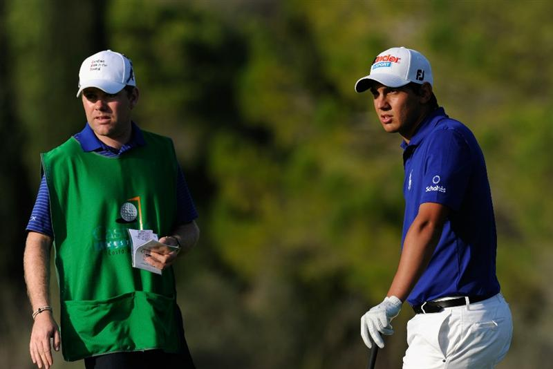 CASTELLON DE LA PLANA, SPAIN - OCTOBER 22:  Matteo Manassero of Italy and caddie ponder on the 15th hole during the second round of the Castello Masters Costa Azahar at the Club de Campo del Mediterraneo on October 22, 2010 in Castellon de la Plana, Spain.  (Photo by Stuart Franklin/Getty Images)