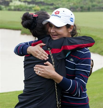 HAIKOU, CHINA - OCTOBER 31:  Lorena Ochoa of Mexico is embraced by actress Catharine Zeta-Jones (L) after her victory in the Mission Hills Start Trophy during day five of the Mission Hills Start Trophy tournament at Mission Hills Resort on October 31, 2010 in Haikou, China. The Mission Hills Star Trophy is Asia's leading leisure liflestyle event which features Hollywood celebrities and international golf stars.  (Photo by Athit Perawongmetha/Getty Images for Mission Hills)