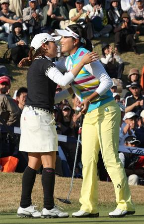 SHIMA, JAPAN - NOVEMBER 08:  Bo Bae Song of South Korea celebrates with Akane Iijima of Japan after winning the Mizuno Classic at Mizuno Classicat Kintetsu Kashikojima Country Club on November 8, 2009 in Shima, Japan.  (Photo by Koichi Kamoshida/Getty Images)