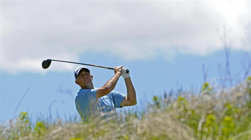 PARKER, CO. - MAY 30: Tom Lehman tees off the 7th hole during the fourth and final round of the 71st Senior PGA Championship at the Colorado Golf Club on May 30, 2010 in Parker, Colorado.  (Photo by Marc Feldman/Getty Images)
