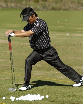 Hidemichi Tanaka stretches on the driving range before  final  round competition at the 2005 Honda Classic March 13, 2005 in Palm Beach Gardens, Florida.