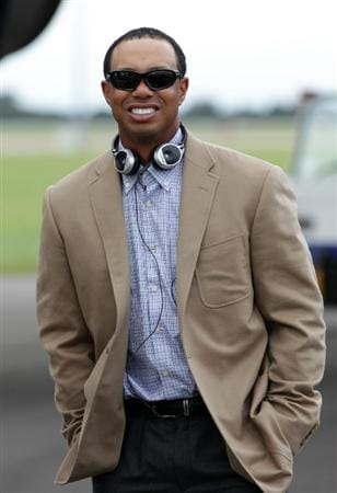 CARDIFF, WALES - SEPTEMBER 27:  In this handout image provided by Ryder Cup Europe, Tiger Woods in relaxed mood as the USA team arrives at Cardiff Airport prior to the start of the 2010 Ryder Cup on September 27, 2010 in Cardiff, Wales.  (Photo by Ryder Cup Europe via Getty Images).  (Photo by Getty Images/Ryder Cup Europe)