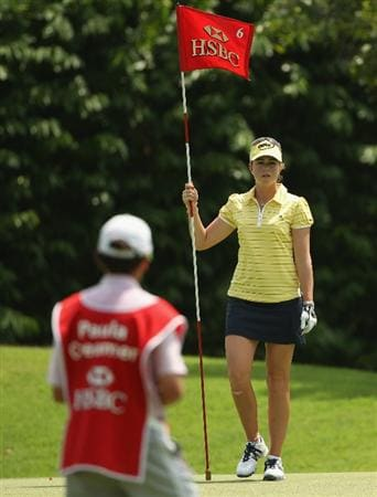 SINGAPORE - FEBRUARY 24:  Paula Creamer of the USA stands with the flag on the sixth hole during the first round of the HSBC Women's Champions at the Tanah Merah Country Club on February 24, 2011 in Singapore.  (Photo by Andrew Redington/Getty Images)