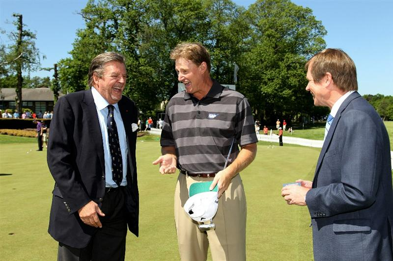 VIRGINIA WATER, ENGLAND - MAY 23:  European Tour Chief Executive George O'Grady (R) and Ernie Els (C) of South Africa (R) congratulate Johann Rupert (L) on becoming an Honorary Lifetime Vice-President of the European Tour during the final round of the BMW PGA Championship on the West Course at Wentworth on May 23, 2010 in Virginia Water, England.  (Photo by Ross Kinnaird/Getty Images)
