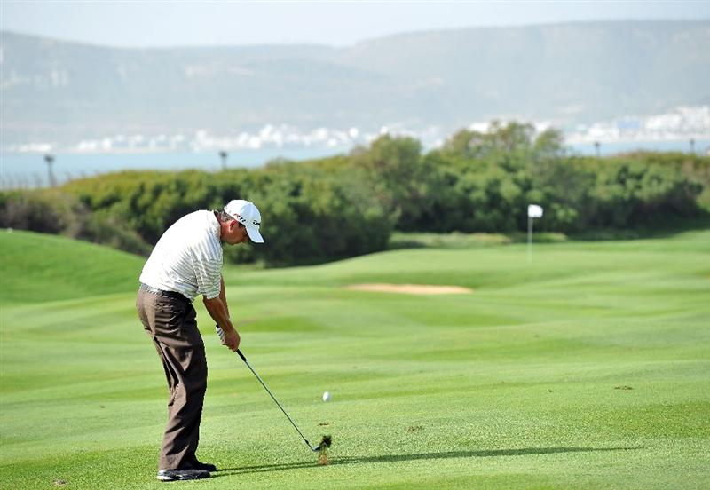AGADIR, MOROCCO - MARCH 31:  Peter Lawrie of Ireland plays a shot during the first round of the Trophee du Hassan II Golf at the Golf du Palais Royal on March 31, 2011 in Agadir, Morocco.  (Photo by Stuart Franklin/Getty Images)