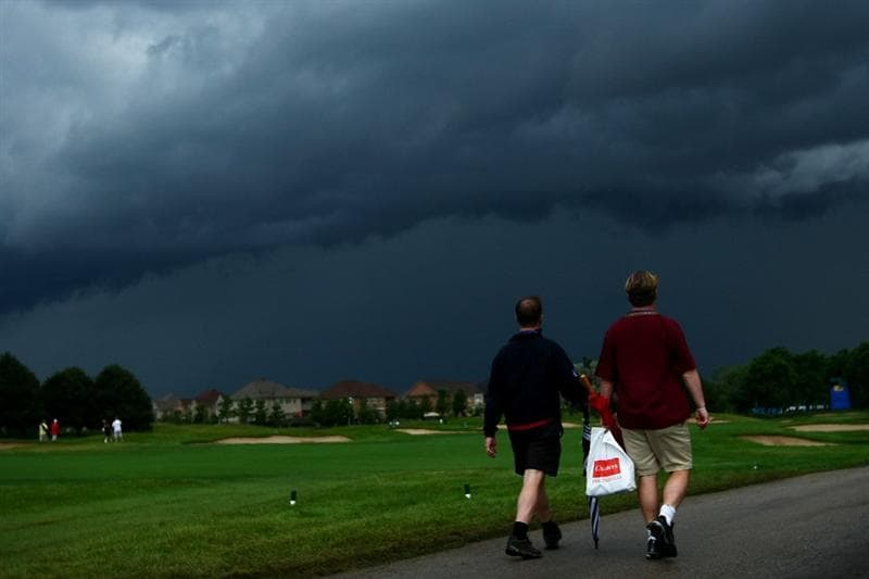 OAKVILLE, ONTARIO - JULY 26:  Spectators leave the golf course after play was cancelled for the day due to an extreme thunderstorm during round three of the RBC Canadian Open at Glen Abbey Golf Club on July 26, 2009 in Oakville, Ontario, Canada.  (Photo by Chris McGrath/Getty Images)