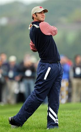 NEWPORT, WALES - SEPTEMBER 30:  Dustin Johnson of the USA watches a shot during a practice round prior to the 2010 Ryder Cup at the Celtic Manor Resort on September 30, 2010 in Newport, Wales.  (Photo by Andy Lyons/Getty Images)