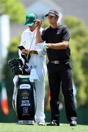 AUGUSTA, GA - APRIL 12:  Dustin Johnson pulls a club in the first fairway during the final round of the 2009 Masters Tournament at Augusta National Golf Club on April 12, 2009 in Augusta, Georgia.  (Photo by Andrew Redington/Getty Images)