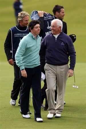 ST ANDREWS, SCOTLAND - OCTOBER 05:  Rory McIlroy of Northern Ireland is hugged by his father and playing partner Gerry McIlroy on the 18th green during the final round of The Alfred Dunhill Links Championship at The Old Course on October 5, 2009 in St.Andrews, Scotland.  (Photo by Andrew Redington/Getty Images)