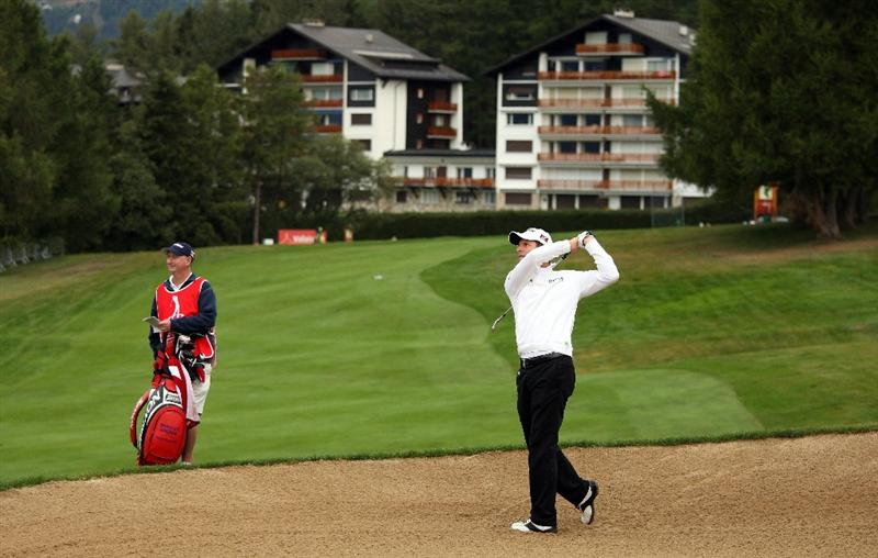 CRANS, SWITZERLAND - SEPTEMBER 04:  Bradley Dredge of Wales plays his second shot on the 12th hole during the second round of The Omega European Masters at Crans-Sur-Sierre Golf Club on September 4, 2009 in Crans Montana, Switzerland.  (Photo by Andrew Redington/Getty Images)
