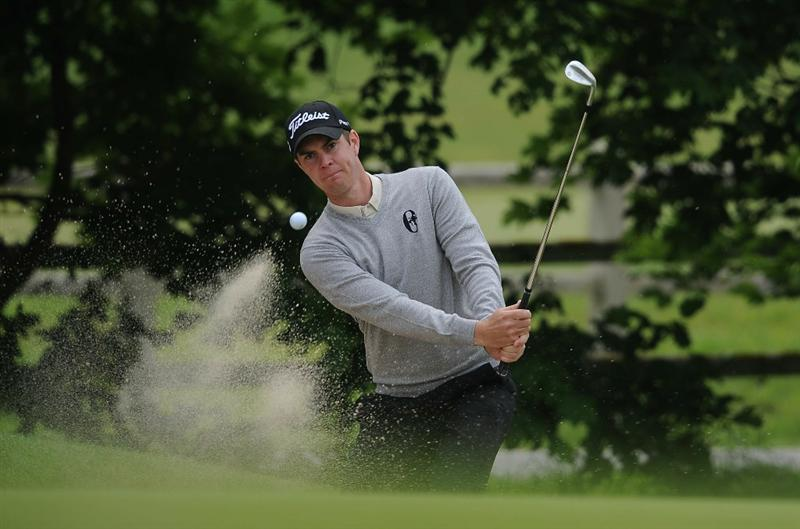LUMBRES, FRANCE - JUNE 17:  Adam Blyth of Australia chips out a bunker during Round One of the Saint-Omer Open at The Aa St Omer Golf Club on June 17, 2010 in Lumbres, France.  (Photo by Christopher Lee/Getty Images)