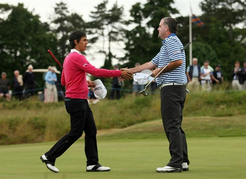 SUNNINGDALE, UNITED KINGDOM - JUNE 07: Matteo Manassero of Italy (L) shakes hands with Kenneth Ferrie of England after finishing their rounds on the 18th green on the New Course during The Open Championship International Final Qualifying at Sunningdale Golf Club on June 7, 2010  in Sunningdale, England. (Photo by Glyn Kirk/Getty Images)