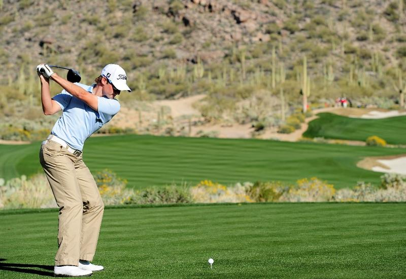 MARANA, AZ - FEBRUARY 17:  Michael Sim of Australia plays his tee shot on the 15th hole during round one of the Accenture Match Play Championship at the Ritz-Carlton Golf Club on February 17, 2010 in Marana, Arizona.  (Photo by Stuart Franklin/Getty Images)
