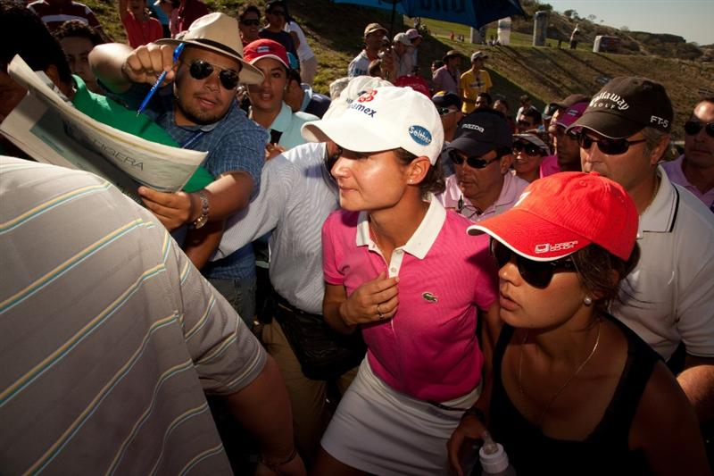 MORELIA, MEXICO - MAY 2: Lorena Ochoa of Mexico is mobbed by fans following the fourth round of the Tres Marias Championship at the Tres Marias Country Club on May 2, 2010 in Morelia, Mexico. (Photo by Darren Carroll/Getty Images)