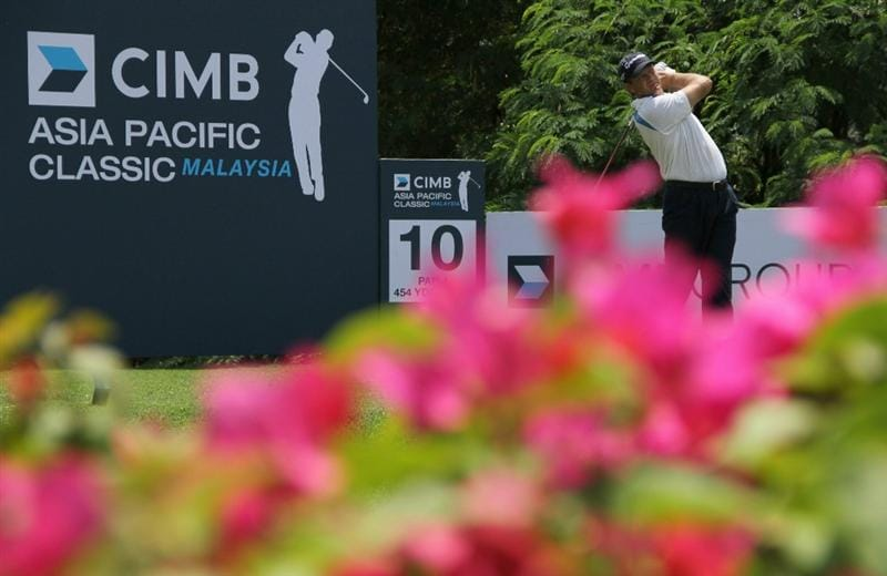 KUALA LUMPUR, MALAYSIA - OCTOBER 28: Retief Goosen of South Africa tees off on the 10th hole during day one of the CIMB Asia Pacific Classic at The MINES Resort & Golf Club on October 28, 2010 in Kuala Lumpur, Malaysia. (Photo by Stanley Chou/Getty Images)