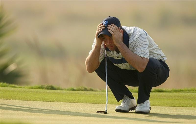 BANGKOK, THAILAND - JANUARY 10:  Oliver Wilson of England lines up a putt during the fourball match on Day two of The Royal Trophy at the Amata Spring Country Club on January 10, 2009 in Bangkok, Thailand.  (Photo by Ian Walton/Getty Images)