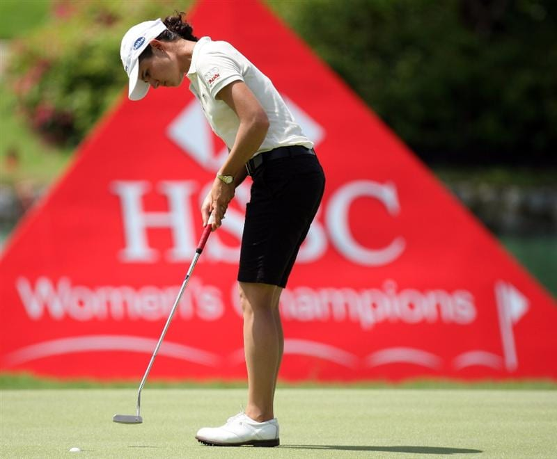 SINGAPORE - MARCH 06:  Lorena Ochoa of Mexico putting on the 7th green during the second round of HSBC Women's Champions at the Tanah Merah Country Club on March 6, 2009 in Singapore.  (Photo by Ross Kinnaird/Getty Images)