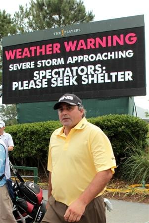 PONTE VEDRA BEACH, FL - MAY 14:  Angel Cabrera of Argentina walks past a warning sign after play was suspended due to severe storms during the third round of THE PLAYERS Championship held at THE PLAYERS Stadium course at TPC Sawgrass on May 14, 2011 in Ponte Vedra Beach, Florida.  (Photo by Scott Halleran/Getty Images)