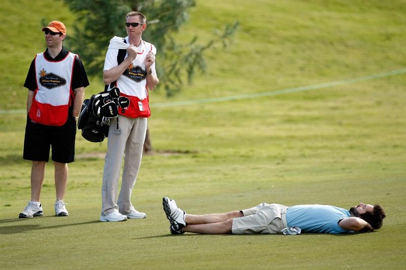 LAS VEGAS - OCTOBER 14:  Singer/songwriter Josh Kelley (R) lies down on the 9th hole fairway during the Justin Timberlake Shriners Hospitals for Children Open Championship Pro-Am at TPC Summerlin October 14, 2009 in Las Vegas, Nevada.  (Photo by Ethan Miller/Getty Images)