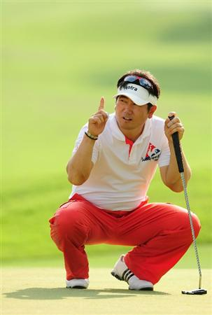 PONTE VEDRA BEACH, FL - MAY 06:  Y.E. Yang of South Korea points on the eighth green during the first round of THE PLAYERS Championship held at THE PLAYERS Stadium course at TPC Sawgrass on May 6, 2010 in Ponte Vedra Beach, Florida.  (Photo by Sam Greenwood/Getty Images)