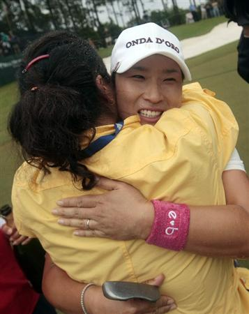 MOBILE, AL - MAY 16: Se Ri Pak of South Korea hugs friends after winning the Bell Micro LPGA Classic at the Magnolia Grove Golf Course on May 16, 2010 in Mobile, Alabama. Pak beat Suzann Pettersen and Brittany Lincicome in the playoff after the tournament was shortened to 54-holes because of rain. (Photo by Dave Martin/Getty Images)