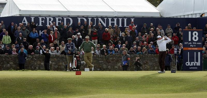 ST ANDREWS, SCOTLAND - OCTOBER 05:  Simon Dyson of England drives off the 18th tee during the final round of The Alfred Dunhill Links Championship at The Old Course on October 5, 2009 in St.Andrews, Scotland. (Photo by David Cannon/Getty Images)