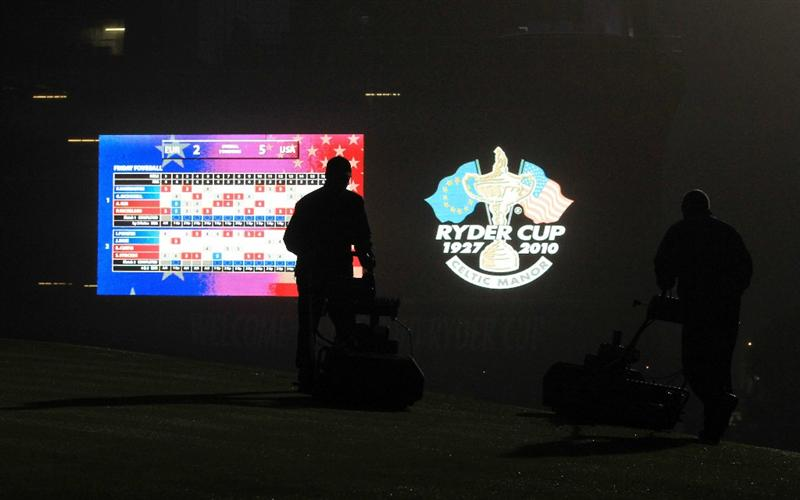 NEWPORT, WALES - SEPTEMBER 28:  Greenkeepers attend to the 18th hole in the early hours during a practice round prior to the 2010 Ryder Cup at the Celtic Manor Resort on September 28, 2010 in Newport, Wales.  (Photo by David Cannon/Getty Images)