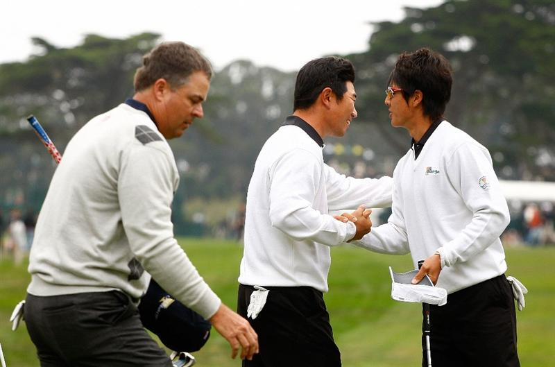 SAN FRANCISCO - OCTOBER 10:  Y.E. Yang, (L) and Ryo Ishikawa of the International Team celebrate their 3&2 victory on the 16th green as Kenny Perry of the USA Team looks on during the Day Three Morning Foursome Matches of The Presidents Cup at Harding Park Golf Course on October 10, 2009 in San Francisco, California.  (Photo by Scott Halleran/Getty Images)